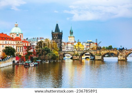 The Old Town with Charles bridge tower in Prague in the evening - stock photo