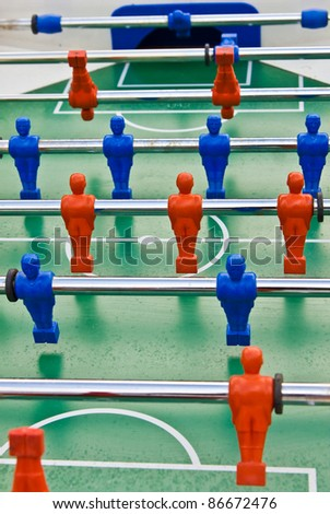 The old toy with blue and red players - stock photo