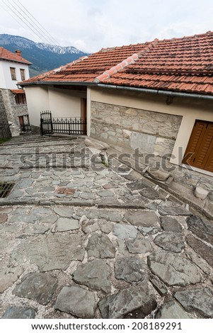 The old traditional stone houses in Metsovo Greek village, Greece, during a cloudy autumn day.