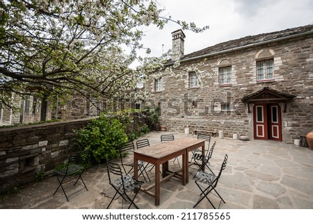 The old traditional stone houses in Zagoria, Greek village, Greece, near Ioannina city, Epirus, during a cloudy spring day.  - stock photo