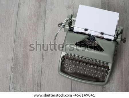 The old used writing machine with the marks of use on the textured backing - stock photo