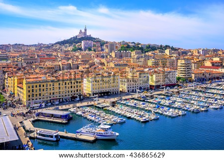 The old Vieux Port and Basilica Notre Dame de la Garde in the historical city center of Marseilles, France - stock photo