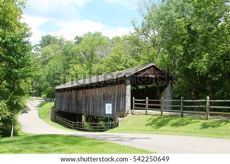 The old vintage covered bridge in the park.