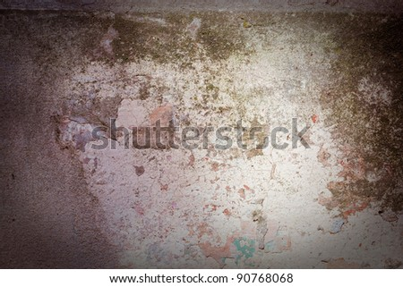 The old wall covered with plaster crashed - stock photo