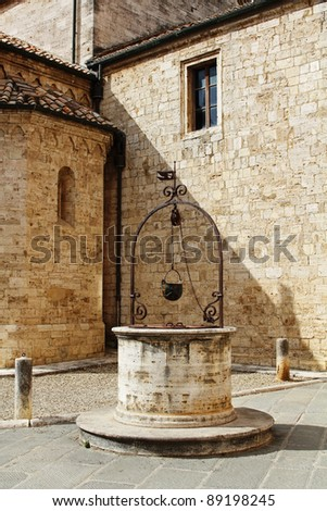 The old water well, Tuscany, Italy - stock photo