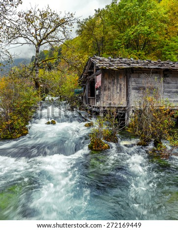 The old watermill. Jiuzhaigou Valley was recognize by UNESCO as a World Heritage Site and a World Biosphere Reserve - China - stock photo