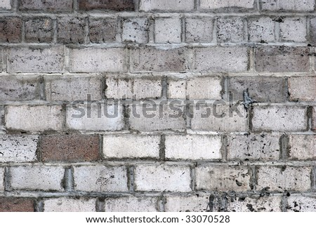 the old white brick city wall