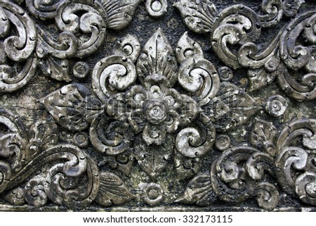 The old White stucco design of native thai style on the Wall - stock photo