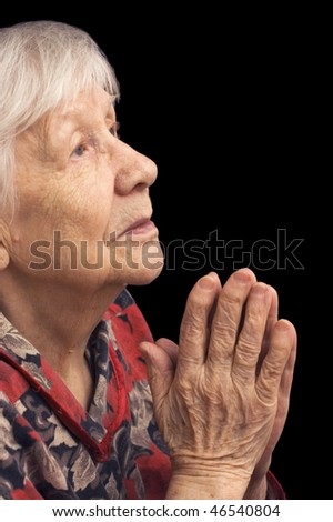 The old woman prays on a black - stock photo