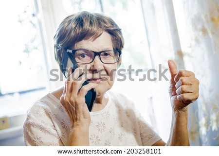 the old woman rejoices - stock photo