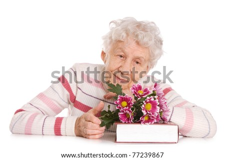 The old woman with a bunch of flowers - stock photo