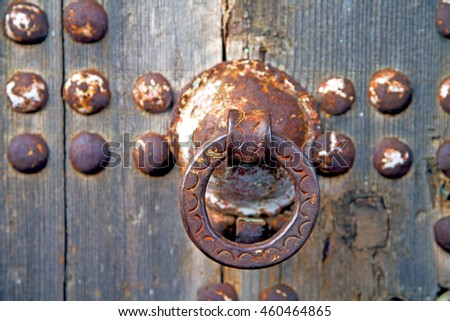 the old wood facade home and rusty safe padlock  - stock photo