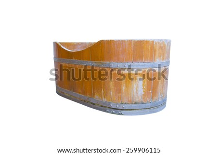 The old wooden bathtub isolated on white background - stock photo