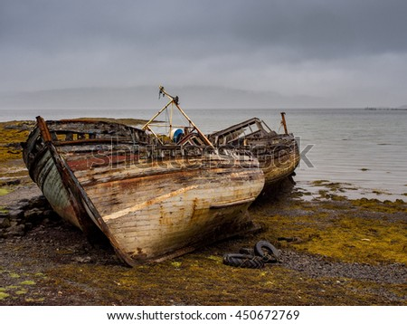 The old wooden boats at Salen Pier, Isle of Mull, Scotland, UK
