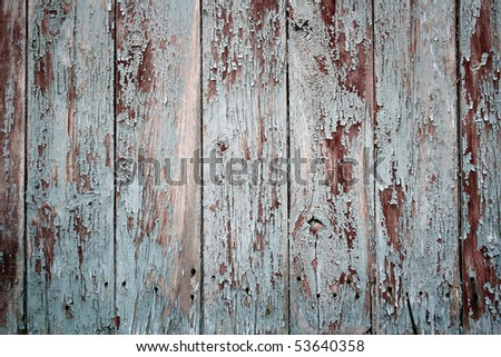 The old wooden planks of a barn with peeling paint - stock photo