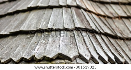 The old wooden shingle roof. Close up. - stock photo