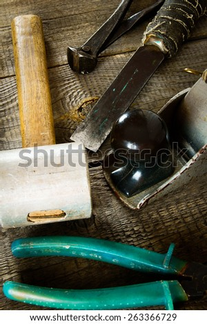The old working tool. Many old working tools (mallet, plane, hammer and others) on a wooden background. - stock photo