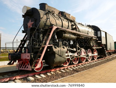 The oldest steam locomotive in the background - stock photo