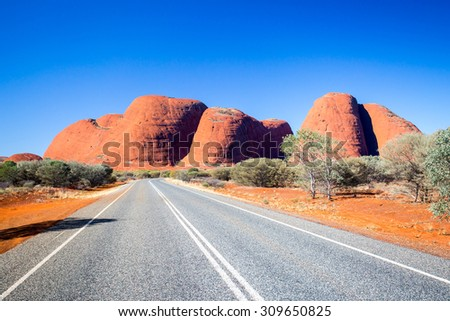 The Olgas and nearby roadscape in the Northern Territory, Australia - stock photo