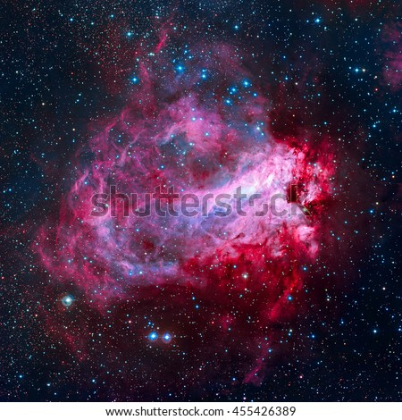 The Omega Nebula, also known as the Swan Nebula, Checkmark Nebula, and the Horseshoe Nebula (Messier 17, M17) is an region in the constellation Sagittarius. Elements of this image furnished by NASA. - stock photo