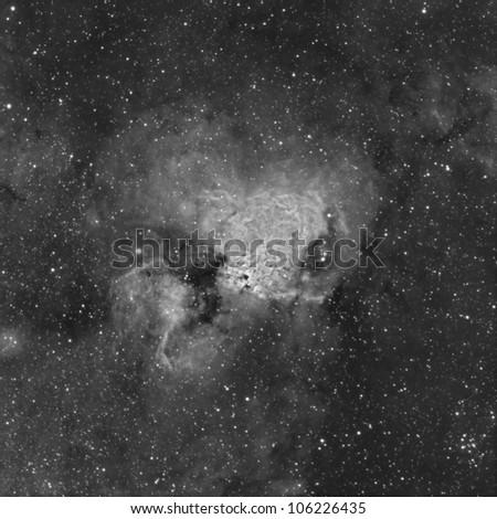 The Omega or Swan Nebula in the Constellation Sagittarius - stock photo