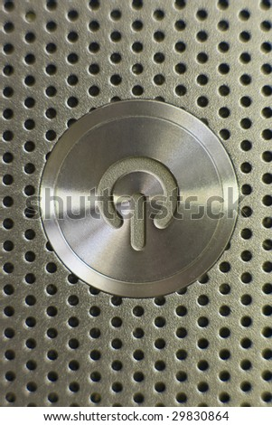 The on and off button of electronic device, laptop computer in aluminum. - stock photo