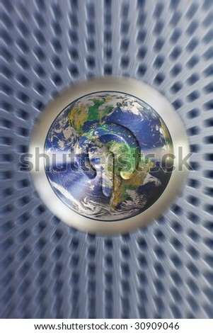 The on and off button of electronic device stylized with earth and focusing motion effect. - stock photo