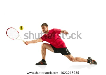 The one caucasian fit man playing tennis at studio. The player isolated on white background in full length