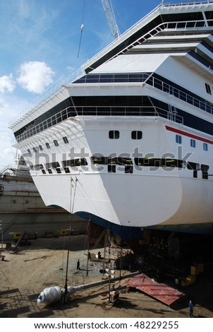 The one of propellers of the cruise liner is taken off for the repairing during the dry dock in Freeport on Grand Bahama Island, The Bahamas. - stock photo