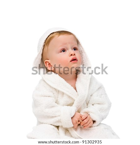 The one-year-old kid in dressing gown on white