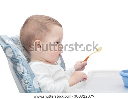 The one-year-old kid is going to eat,  isolated on the white - stock photo