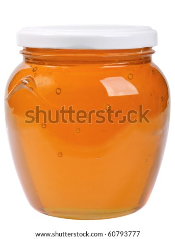 The only closed glass jar with honey. Isolated on white background. Studio photography. - stock photo