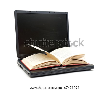 The open book laying on the laptop isolated on white - stock photo