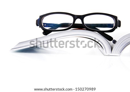 The opened book and glasses - stock photo