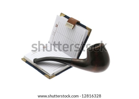 The opened notebook and pipe on a white background