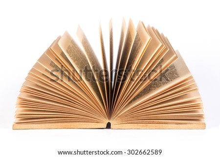 The opened old book on white background