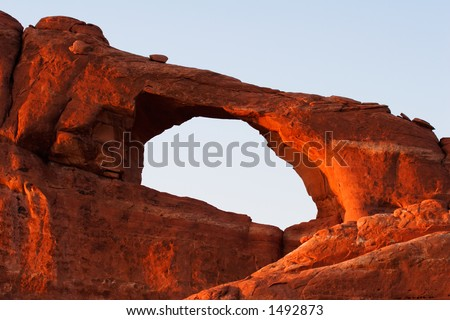 The opening of Skyline Arch in the late evening sun.  Arches National Park, Utah, USA.