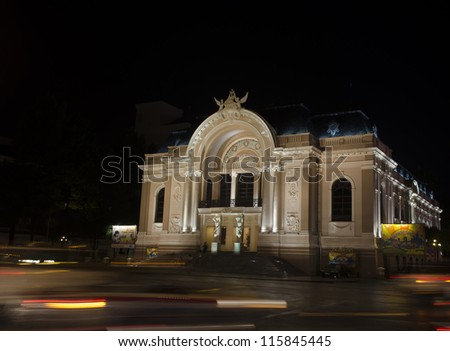 The opera house of Saigon Vietnam with stream of passing traffics - stock photo