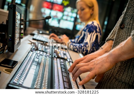 The operator controls the remote recording process news program - stock photo