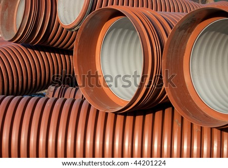 The orange  goffered pipe close-up - stock photo