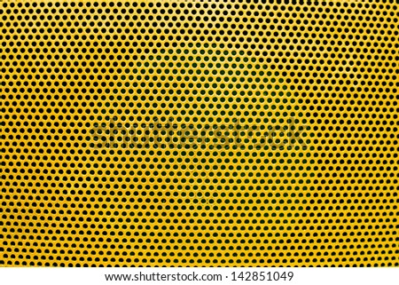 the orange grate background with holes - stock photo