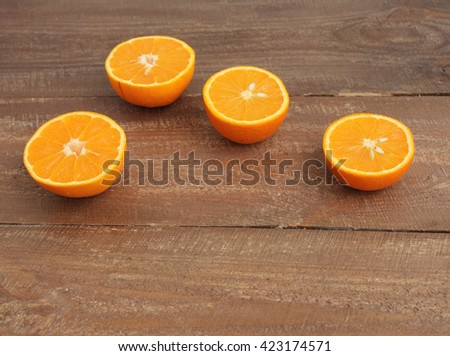 The orange on a wooden background