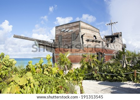 The original bar built in a shape of a pirate ship standing on Half Moon Cay island in The Bahamas. - stock photo