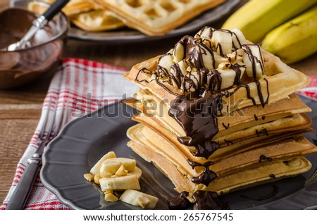 The original Belgian waffles with bananas, nuts and chocolate - stock photo