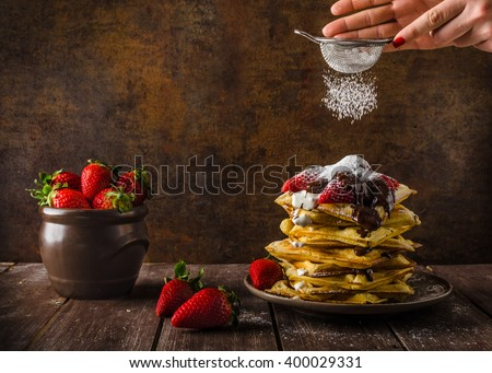 The original Belgian waffles with strawberries, chocolate and sprinkled with sugar - stock photo