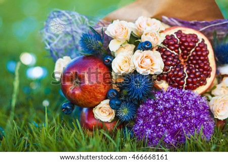 The original unusual edible bouquet of fruits on a grass
