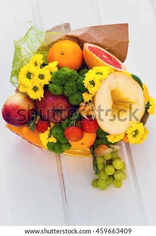 The original unusual edible bouquet of fruits on a wood - stock photo