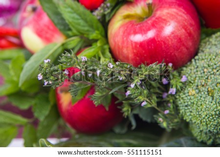 The original unusual edible bouquet of vegetables and fruits, closeup of Apple