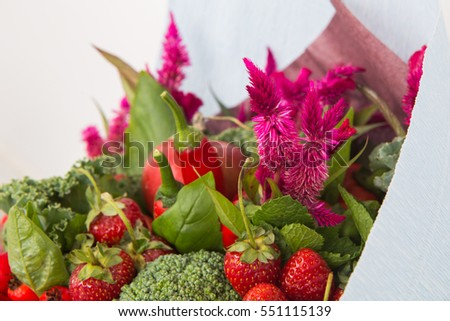 The original unusual edible bouquet of vegetables and fruits, closeup of Strawberry