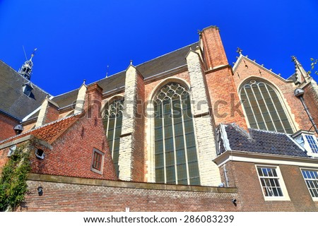 The Oude Kerk (Old Church) in the old center of Amsterdam, the Netherlands - stock photo